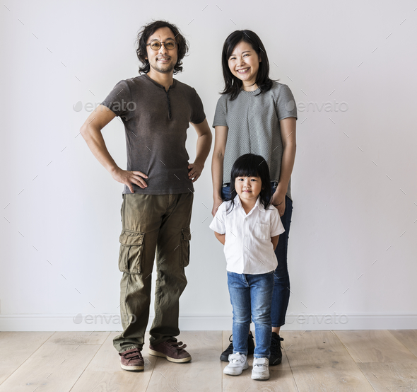 Cheerful Asian family move to new house - Stock Photo - Images