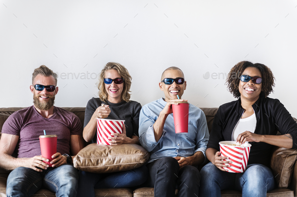 Group of friends having fun watching movie - Stock Photo - Images