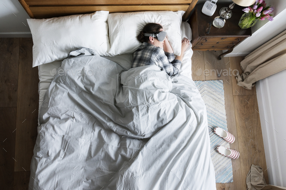 Caucasian woman sleeping with an eye cover on - Stock Photo - Images
