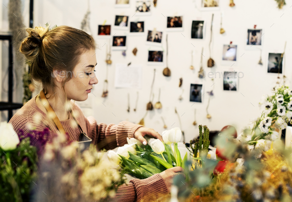 Woman working in a flower shop - Stock Photo - Images
