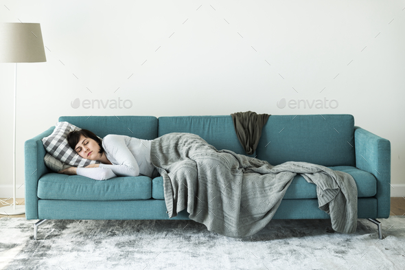 Woman sleeping on the sofa - Stock Photo - Images
