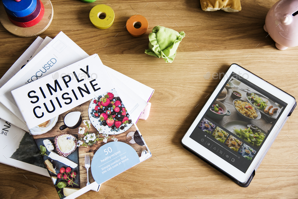 Tablet and magazines on table - Stock Photo - Images