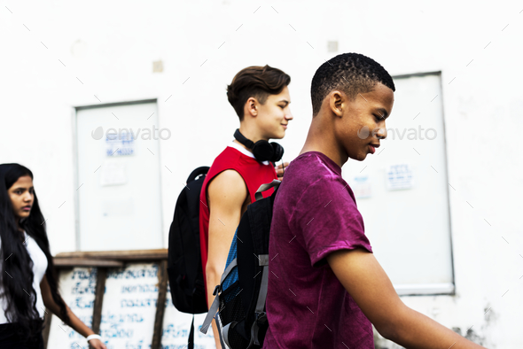 Group of diverse youth walking together - Stock Photo - Images