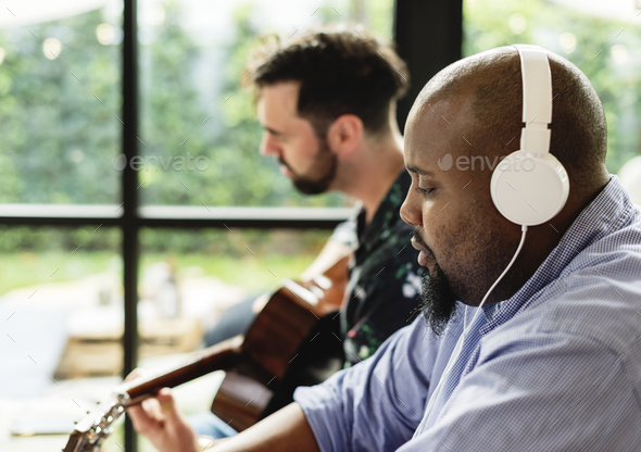 Men enjoying the music together - Stock Photo - Images