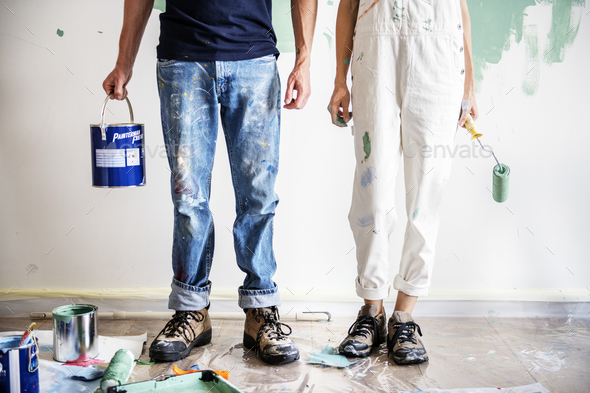Couple renovating the house - Stock Photo - Images