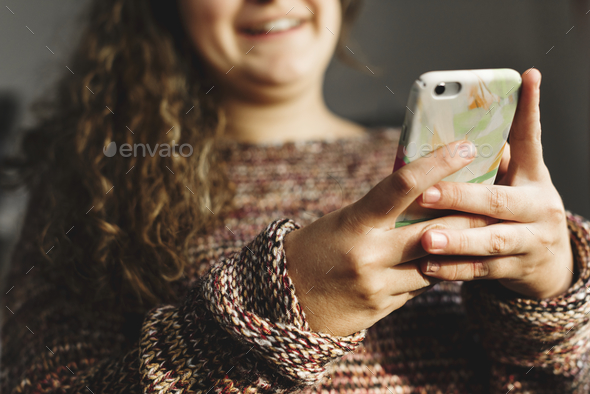 Teenage girl using a smartphone on a bed social media and addiction concept - Stock Photo - Images