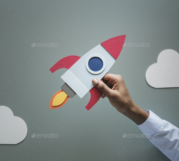 Hand holding rocketship startup business - Stock Photo - Images