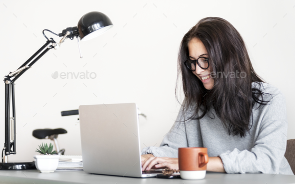 Woman using computer laptop - Stock Photo - Images