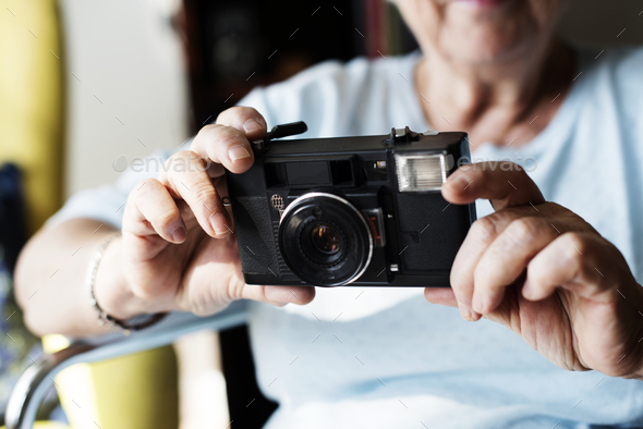 Senior woman taking a picture - Stock Photo - Images