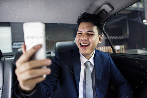 Businessman sitting in the car - Stock Photo - Images