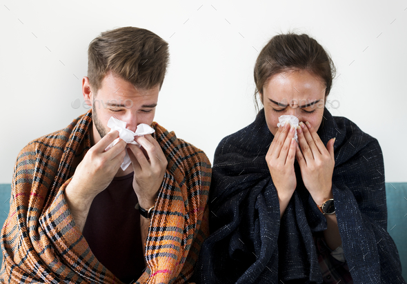 Sick couple with runny nose - Stock Photo - Images