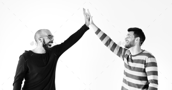 Two men giving a high five - Stock Photo - Images
