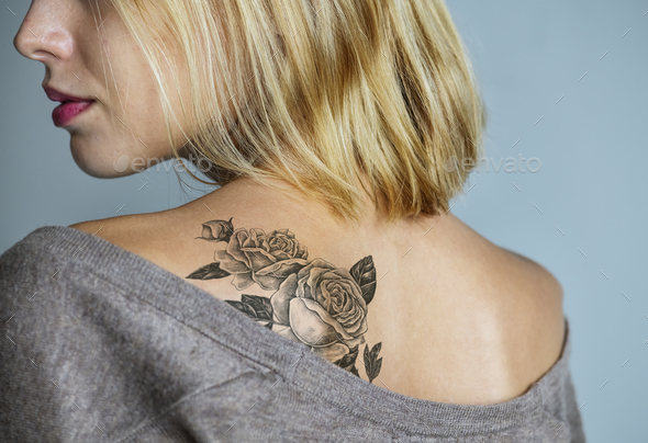 Back tattoo of a woman - Stock Photo - Images