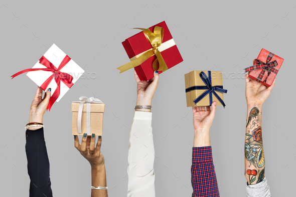 Diversity hands holding gifts - Stock Photo - Images
