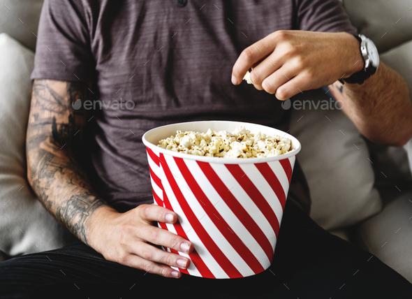 Man eating popcorn - Stock Photo - Images