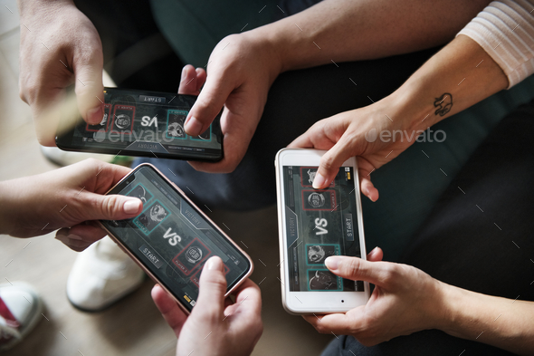 Group of diverse friends playing game on mobile phone - Stock Photo - Images