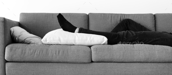 Man sleeping on the sofa - Stock Photo - Images