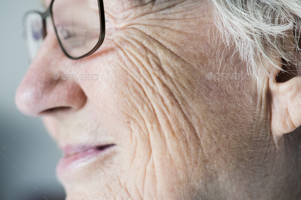 Side closeup portrait of white elderly woman - Stock Photo - Images