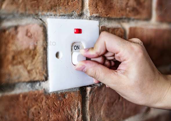 Closeup of switch on brick wall - Stock Photo - Images