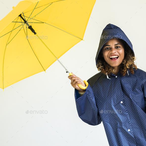 Happy girl with yellow umbrella - Stock Photo - Images
