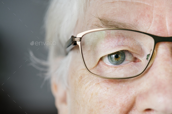 Portrait of white elderly woman closeup on eyes wearing specatac - Stock Photo - Images