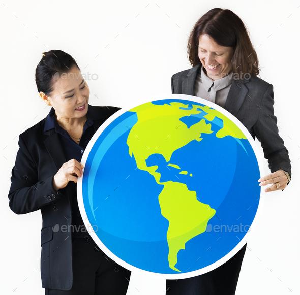 Businesswomen holding globe icon - Stock Photo - Images
