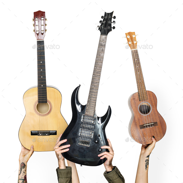 Variation hands holding guitars - Stock Photo - Images