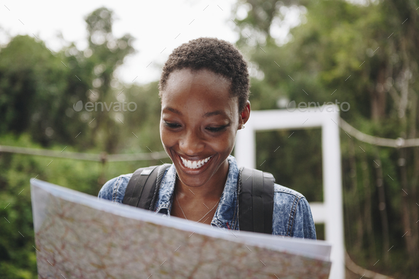 African American woman looking at a map - Stock Photo - Images