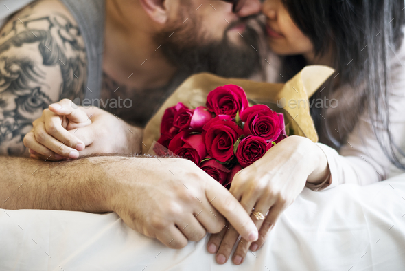Husband surprised wife with red rose bouquet - Stock Photo - Images