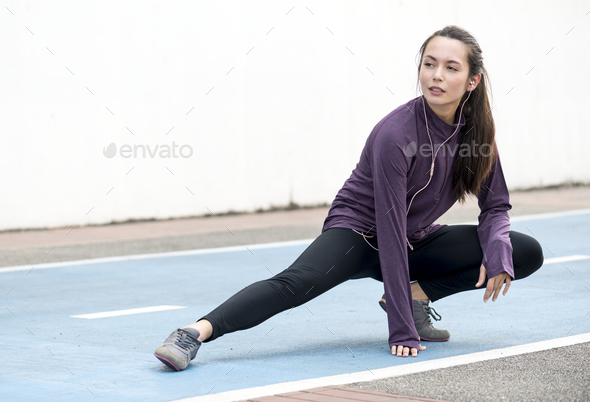 White woman stretching before exercise - Stock Photo - Images