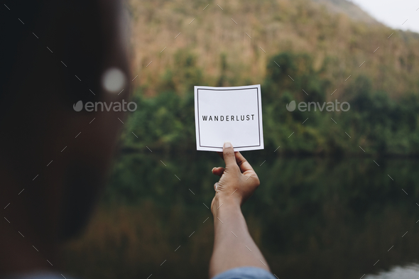 Wanderlust text in nature travel and modern trend concept - Stock Photo - Images