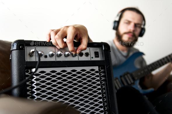 Caucasian man praticing electric guitar - Stock Photo - Images