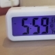 Electronic Alarm Clock Stands on a Bedside Table in the Room - VideoHive Item for Sale