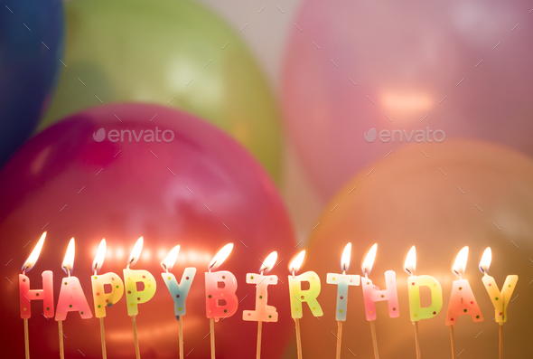 Closeup of lit birthday candles birthday wishes concept - Stock Photo - Images
