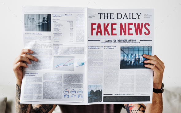 Fake news headline on a newspaper - Stock Photo - Images