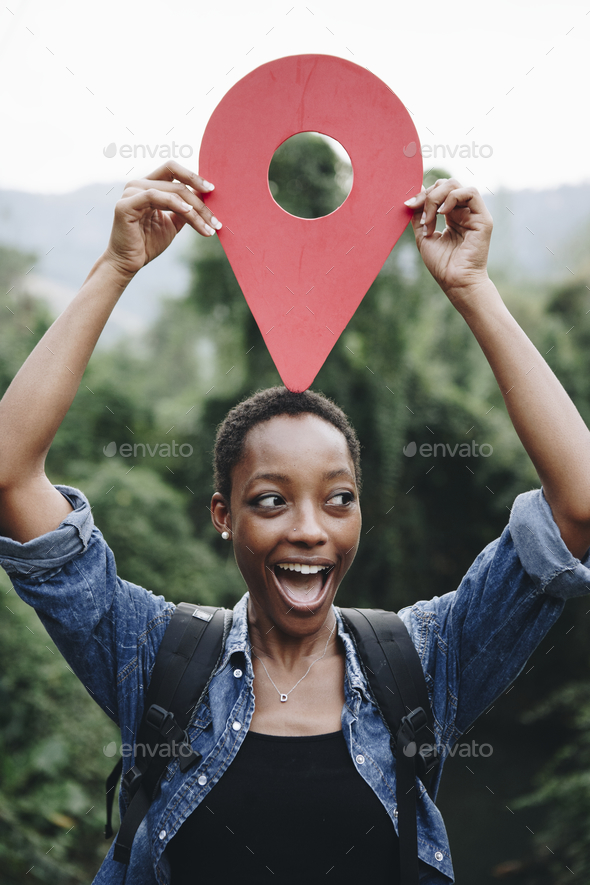 African American woman with a checkpoint symbol - Stock Photo - Images