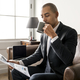 Businessman reading newspaper and having coffee - PhotoDune Item for Sale