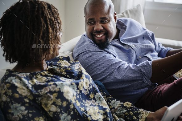 Black couple relaxing at home together - Stock Photo - Images
