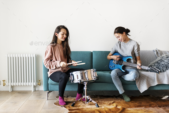 Women playing music together at home - Stock Photo - Images