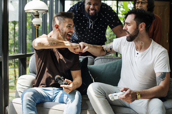 Friends enjoying video game together - Stock Photo - Images