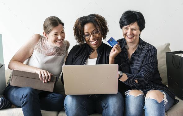 Women enjoy shopping online - Stock Photo - Images