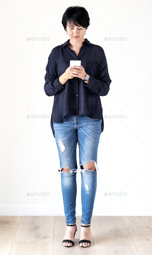 White woman using mobile phone - Stock Photo - Images