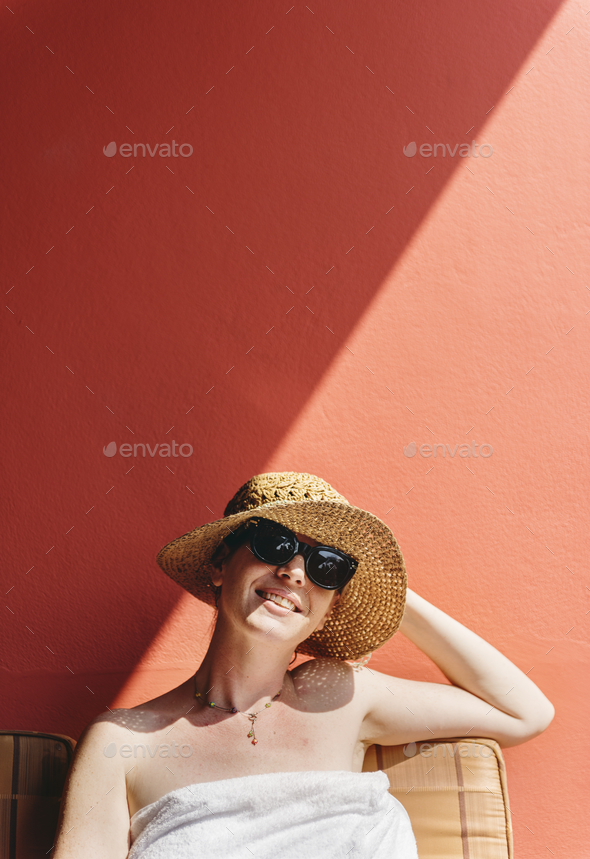 Caucasian woman sunbathing in summertime - Stock Photo - Images