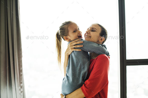 Mom holding daughter - Stock Photo - Images