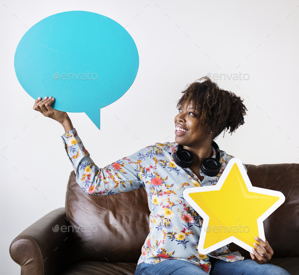 Happy African American holding copy space speech bubble and a star sign - Stock Photo - Images