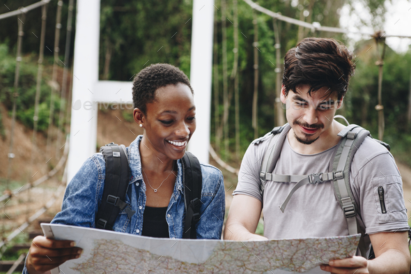 Friends looking at a map - Stock Photo - Images