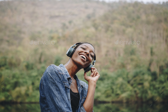 Woman listening to music in nature - Stock Photo - Images