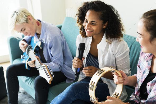 Group of people enjoying music icons - Stock Photo - Images