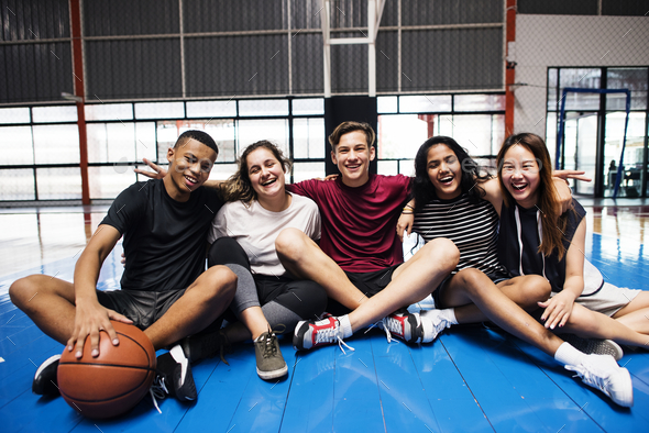 Group of young teenager friends on a basketball court relaxing portrait - Stock Photo - Images