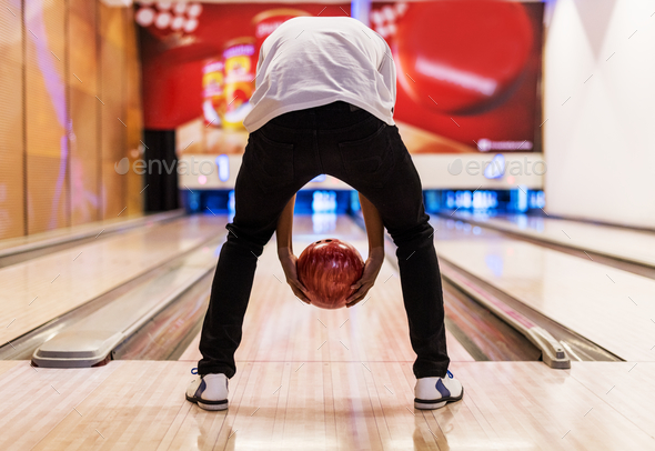 Boy bowling with two hands - Stock Photo - Images